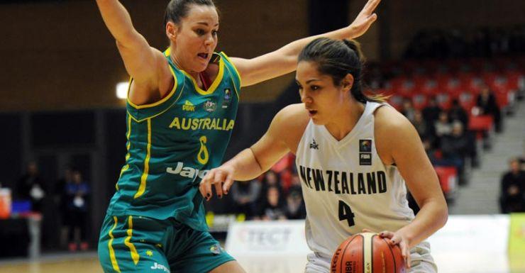Australia's Tess Madgen attempts to block Kalani Purcell.