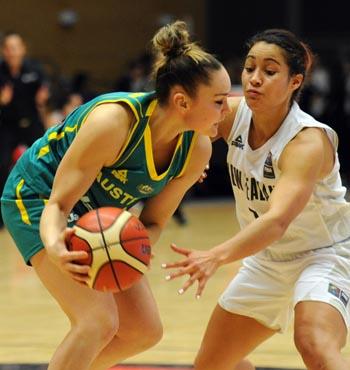 Australia's Kelly Wilson, attacks New Zealand's Jordan Hunter.