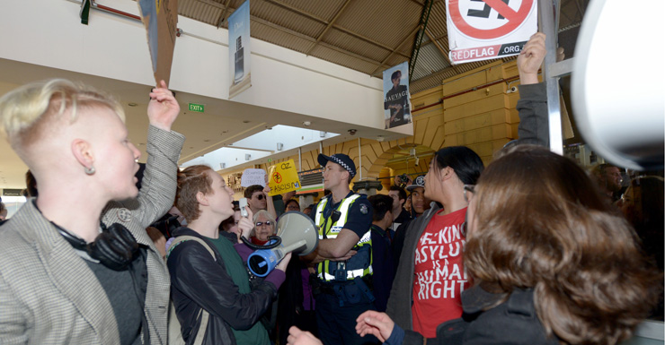 Protesters rally inside Flinders Street Station.
