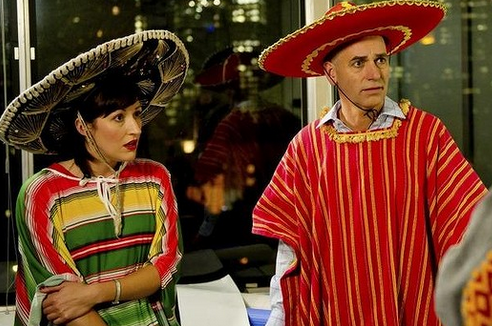 Celia Pacquola (Nat) and Rob Sitch (Tony), are often made to endure the bizarre behaviour of their colleagues. Photo: Supplied.