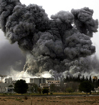 Smoke rises after an air strike on the Syrian town of Kobane.