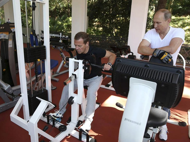 The pair use the gym at the government residence in Sochi. Photo: AAP