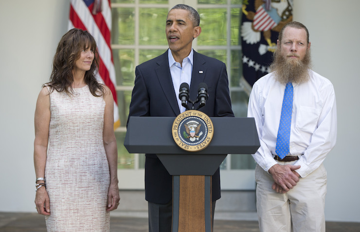 President Barack Obama (centre), Jani Bergdahl (left) and Bob Bergdahl (right) during a news conference on May 31, 2014 about the release of Sgt. Bergdahl. Photo: AAP