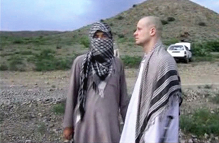 In this image taken from video obtained from Voice Of Jihad Website, Sgt. Bergdahl, right, stands with a Taliban fighter in eastern Afghanistan. Photo: AAP