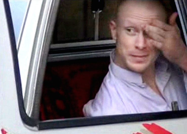 Sgt. Bowe Bergdahl sits in a vehicle guarded by the Taliban. Photo: AAP