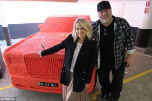 Kyle and Jackie O in front of the gag car. Kiis FM