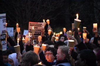 The crowds came to Treasury Gardens in Melbourne with candles Photo: ABC News
