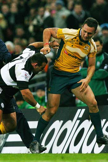 Cooper and Federico Pucciariello fight during the Wallabies clash with the Barbarians in 2008. Photo: Getty