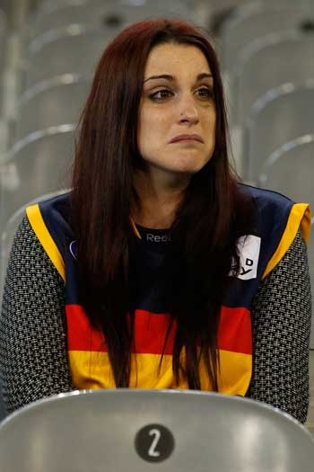 The toll on this supporter shows after Friday night's loss to Hawthorn. Photo: Getty