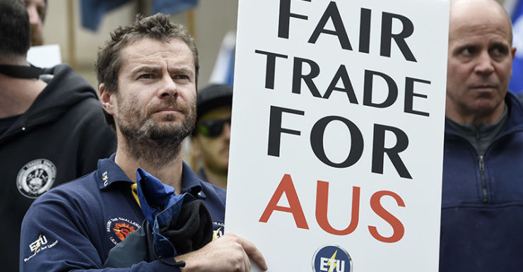 Union and community members rally to demand urgent changes to the China Australia Free Trade Agreement to protect jobs and safety standards on the front steps of Victorian Parliament in Melbourne on Friday, August 28, 2015. (AAP Image/Mal Fairclough) NO ARCHIVING, EDITORIAL USE ONLY