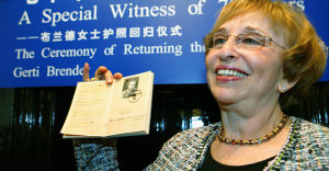 Gerti Brender with the passport she used to gain entry to Shanghai. She later settled in Australia. Photo: Getty.