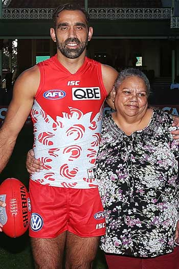 Goodes with his mother, Lisa Sansbury, who designed the Swans Indigenous Round guernsey. Photo: Getty