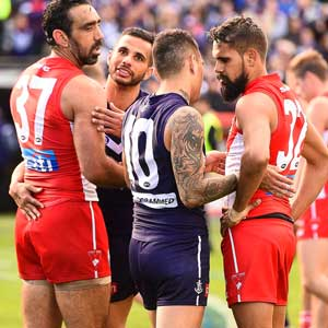 Fremantle's Indigenous players Danyle Pearce and Michael Walters chat to Goodes and Lewis Jetta of the Swans. Photo: Getty