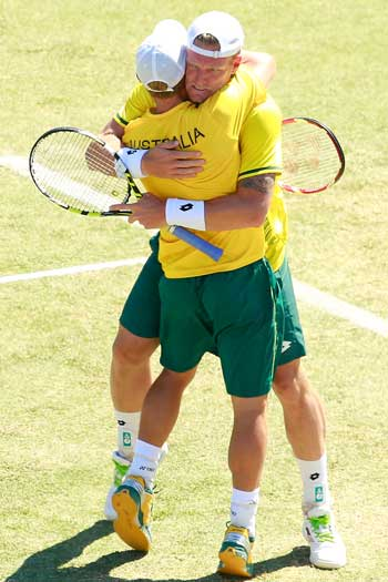 Lleyton Hewitt and Sam Groth were instrumental in getting Australia into the semis with a win over Kazakhstan. Photo: Getty