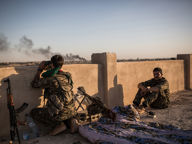 Kurdish fighters are pictured during clashes with fighters from the Islamic State group on the outskirts of Syrian city of Hasakeh on June 30, 2015. AFP PHOTO/UYGAR ONDER SIMSEK (Photo credit should read UYGAR ONDER SIMSEK/AFP/Getty Images)