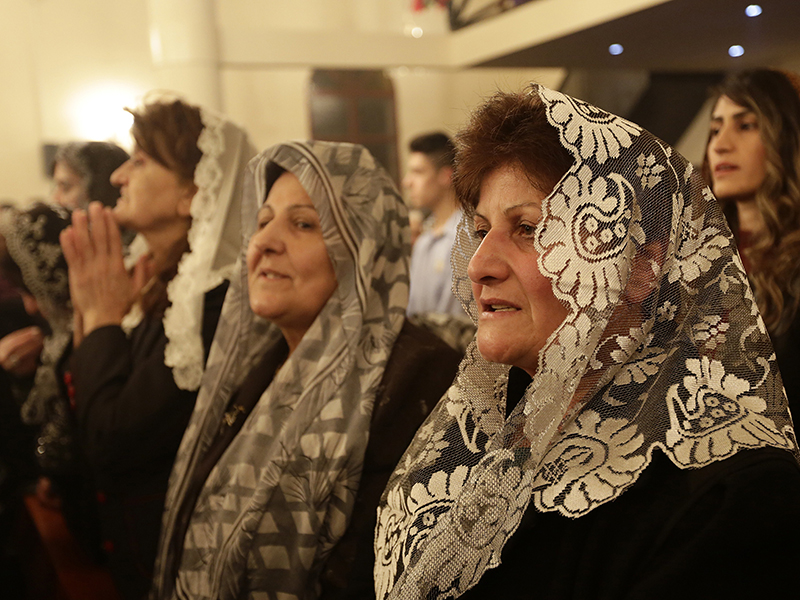 Assyrian Christians from Iraq, Syria and Lebanon attend a Christmas mass at Saint Georges church in an eastern Beirut suburb on December 25, 2014. AFP PHOTO / ANWAR AMRO (Photo credit should read ANWAR AMRO/AFP/Getty Images)