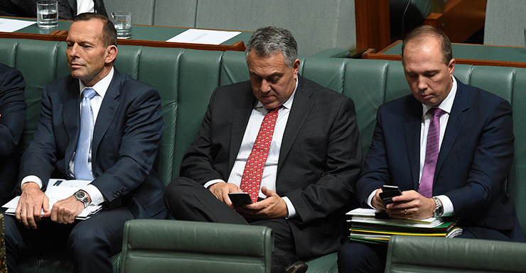 Australian Prime Minister Tony Abbott (left), Treasurer Joe Hockey (centre) and Minister for Immigration Peter Dutton during a division in the House of Representatives Question Time at Parliament House in Canberra, Thursday, Aug. 13, 2015. (AAP Image/Mick Tsikas) NO ARCHIVING