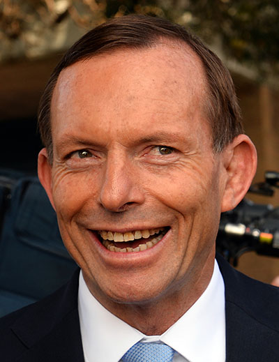 Australian opposition leader Tony Abbott smiles as he leaves a polling station after casting his vote in Sydney on September 7, 2013. Australians began voting in national elections with conservative challenger Tony Abbott heading for a thumping victory over Labor Prime Minister Kevin Rudd. AFP PHOTO / Saeed KHAN (Photo credit should read SAEED KHAN/AFP/Getty Images)