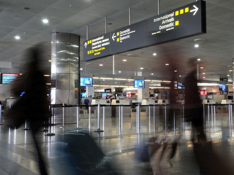 Passengers face long queues.