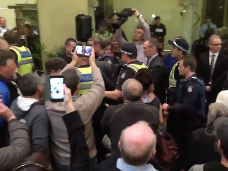 Bendigo Mayor is escorted out by police.