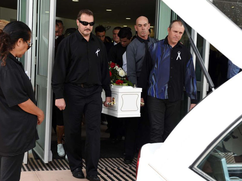 The coffin is carried out after the funeral service.