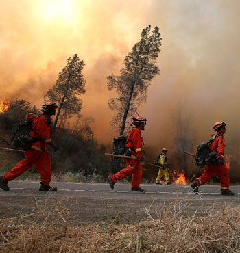 Firefighters conduct a backfire operation to head off the Rocky Fire near Clearlake, California.