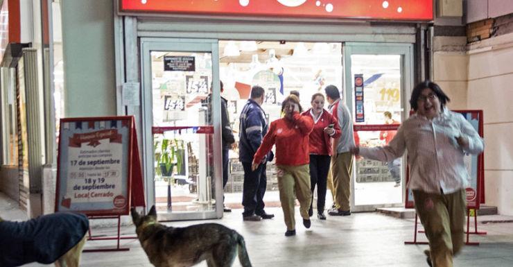 Frightened people flee a supermarket in Santiago.