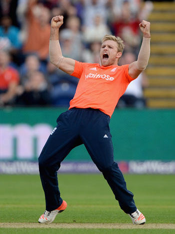England's David Willey celebrates dismissing Australian captain Steven Smith during the NatWest T20 International match in Cardiff. Photo: Getty