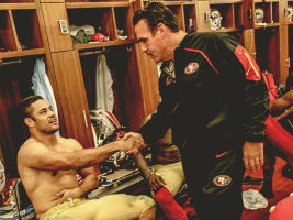 Hayne (left) is congratulated by 49ers head coach Jim Tomsula in the locker room.