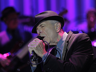 Canadian singer Leonard Cohen performs on October 3, 2012 at the Palau Sant Jordi hall in Barcelona. AFP PHOTO/ JOSEP LAGO RESTRICTED TO EDITORIAL USE - NO MARKETING - NO ADVERTISING CAMPAIGNS - DISTRIBUTED AS A SERVICE TO CLIENTS        (Photo credit should read JOSEP LAGO/AFP/GettyImages)