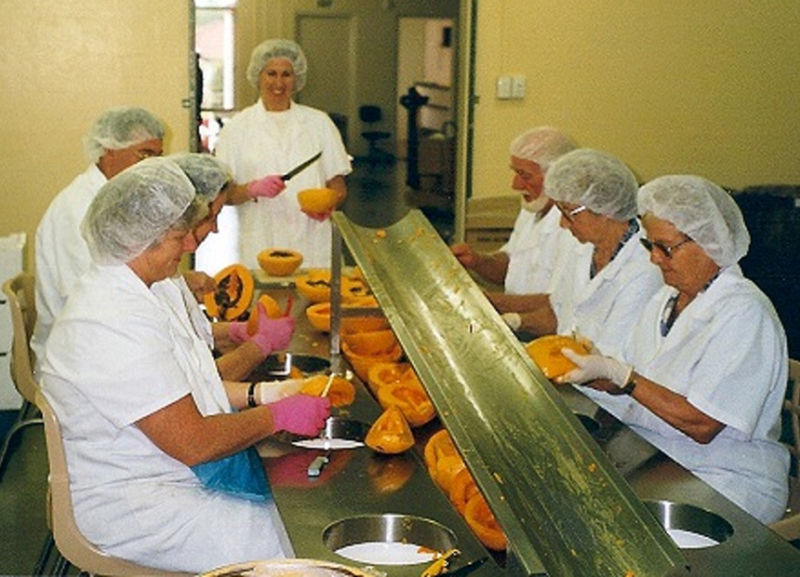 Employees at the factory hard at work peeling papaws.