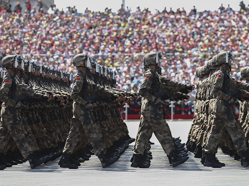 BEIJING, CHINA - SEPTEMBER 03:  Chinese troops march during a military parade marking the 70th Anniversary of the 'Victory of Chinese People's Resistance against Japanese Aggression and World Anti-Fascist War' at Tiananmen Square on September 3, 2015 in Beijing, China. China is marking the 70th anniversary of the end of World War II and its role in defeating Japan with a new national holiday and a military parade in Beijing. (Photo by Rolex Dela Pena - Pool/Getty Images)