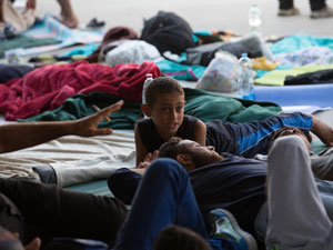 Migrants gather in the transit zone of Keleti station which remains closed to them in central Budapest on September 2. Photo: Getty