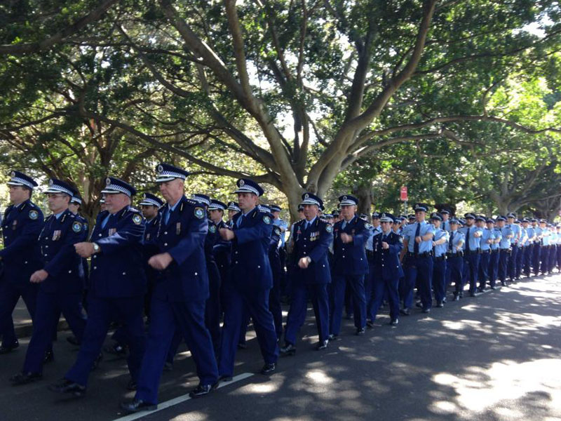 NSW Police march through Hyde Park in Sydney to mark the day.
