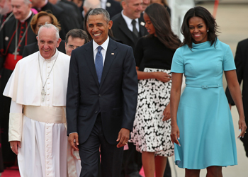 Obama's wife and two daughters also welcomed Pope Francis. Photo: Getty