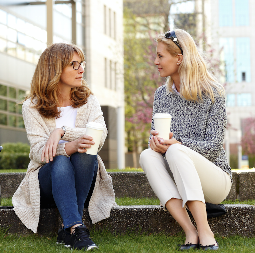 two ladies talking over a coffee