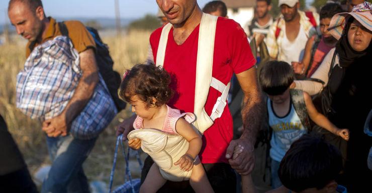 Migrants cross the border between Greece and Macedonia.