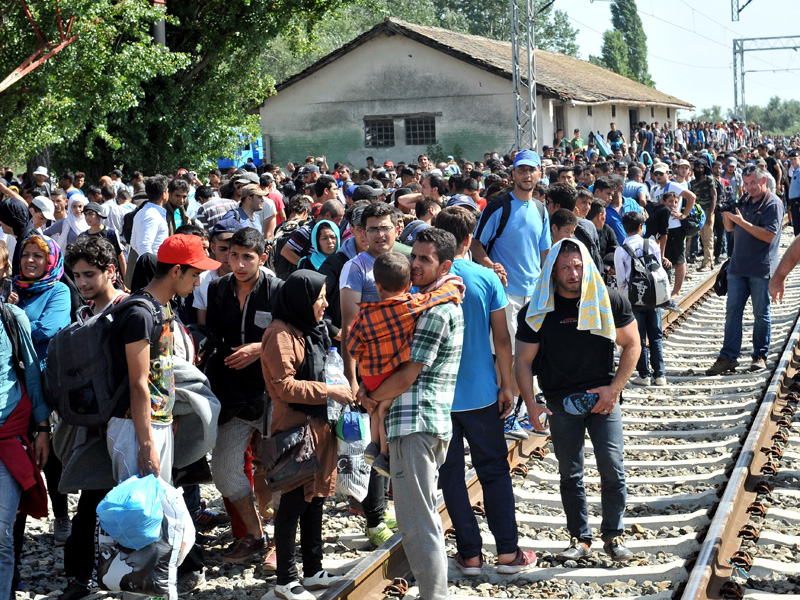 Migrants wait at a railway station, near the Serbia and Croatia border.