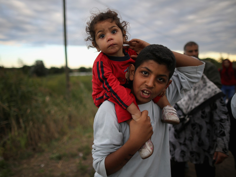 Refugees cross the border from Serbia into Hungary. Photo: Getty