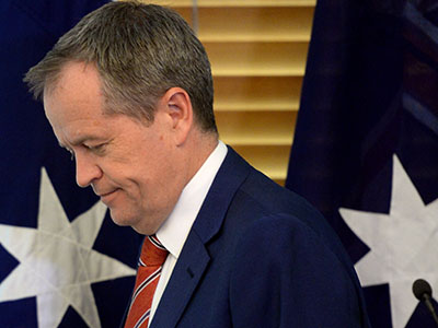 Australian Federal Opposition Leader Bill Shorten departs the stage after addressing the Federal Labor Caucus meeting inside the Federal Labor Party Room meeting at Australian Parliament House in Canberra, Tuesday, Sept. 15, 2015. Australian Prime Minister designate Malcolm Turnbull last night won the Australian Federal Leadership in a party ballot vote, at Australian Parliament House. (AAP Image/Sam Mooy) NO ARCHIVING