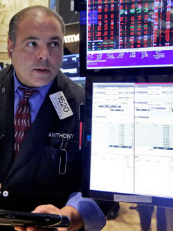 Trader Anthony Riccio was on the floor of the New York Stock Exchange as more signs of weakness in China's economy send global stock markets sharply lower. Photo: AAP