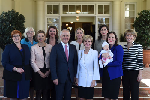 The PM poses with female members of the government. Photo: AAP