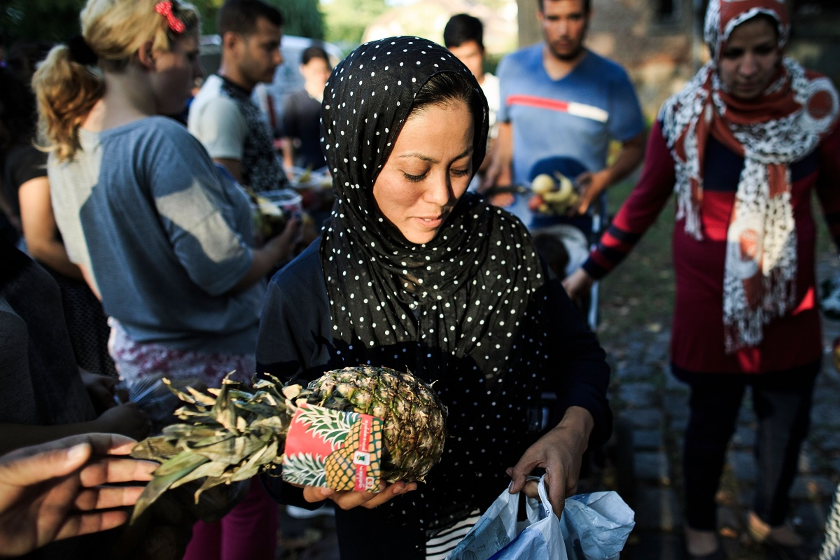 woman-refugee-germany-donation