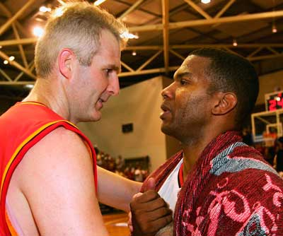 Andrew Gaze and Ricky Grace after the latter's final NBL game. Photo: Getty