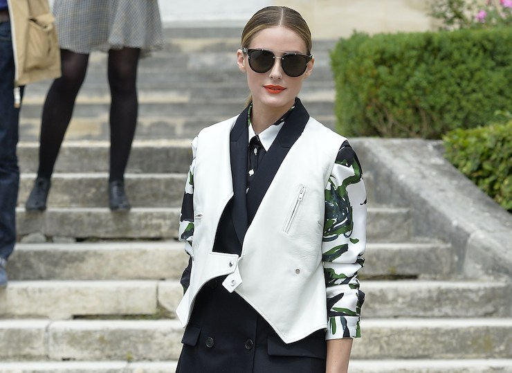 Olivia Palermo wears a black-and-white gilet.