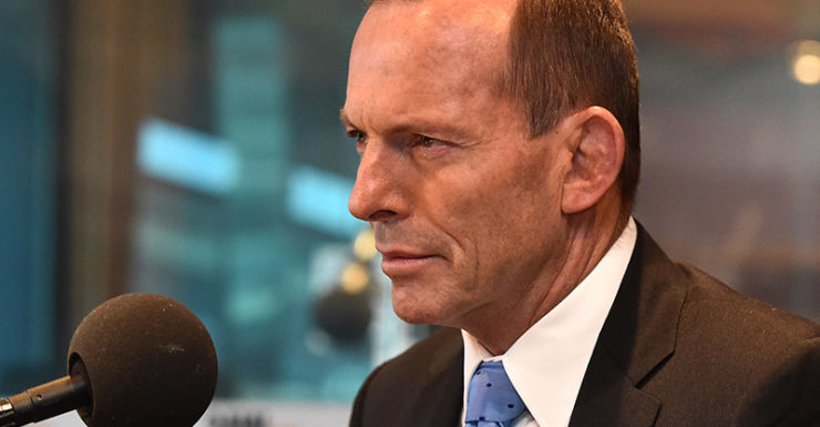 Former Prime Minister Tony Abbott speaks to Neil Mitchell at the 3AW studio in Melbourne, Thursday, Oct. 1, 2015. Abbott refused to say if he has forgiven Malcolm Turnbull for taking his job. (AAP Image/Julian Smith) NO ARCHIVING