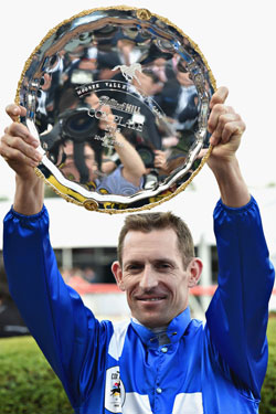 Bowman lifts the Cox Plate after steering Winx to a huge win. Photo: Getty