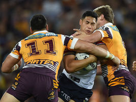 BRISBANE, AUSTRALIA - SEPTEMBER 25: Roger Tuivasa-Sheck of the Roosters is tackled during the NRL First Preliminary Final match between the Brisbane Broncos and the Sydney Roosters at Suncorp Stadium on September 25, 2015 in Brisbane, Australia. (Photo by Matt Roberts/Getty Images)
