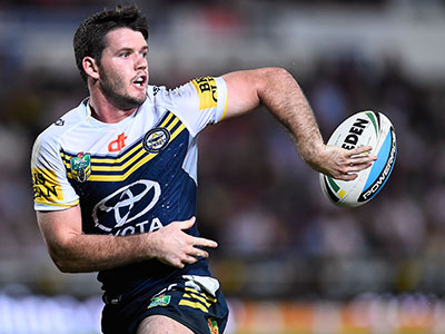 TOWNSVILLE, AUSTRALIA - JUNE 27: Lachlan Coote of the Cowboys passes the ball during the round 16 NRL match between the North Queensland Cowboys and the Cronulla Sharks at 1300SMILES Stadium on June 27, 2015 in Townsville, Australia. (Photo by Ian Hitchcock/Getty Images)