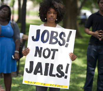 """A demonstrator holds a sign protesting America's """"War on Drugs"""" near the White House in America. Photo: Getty"""